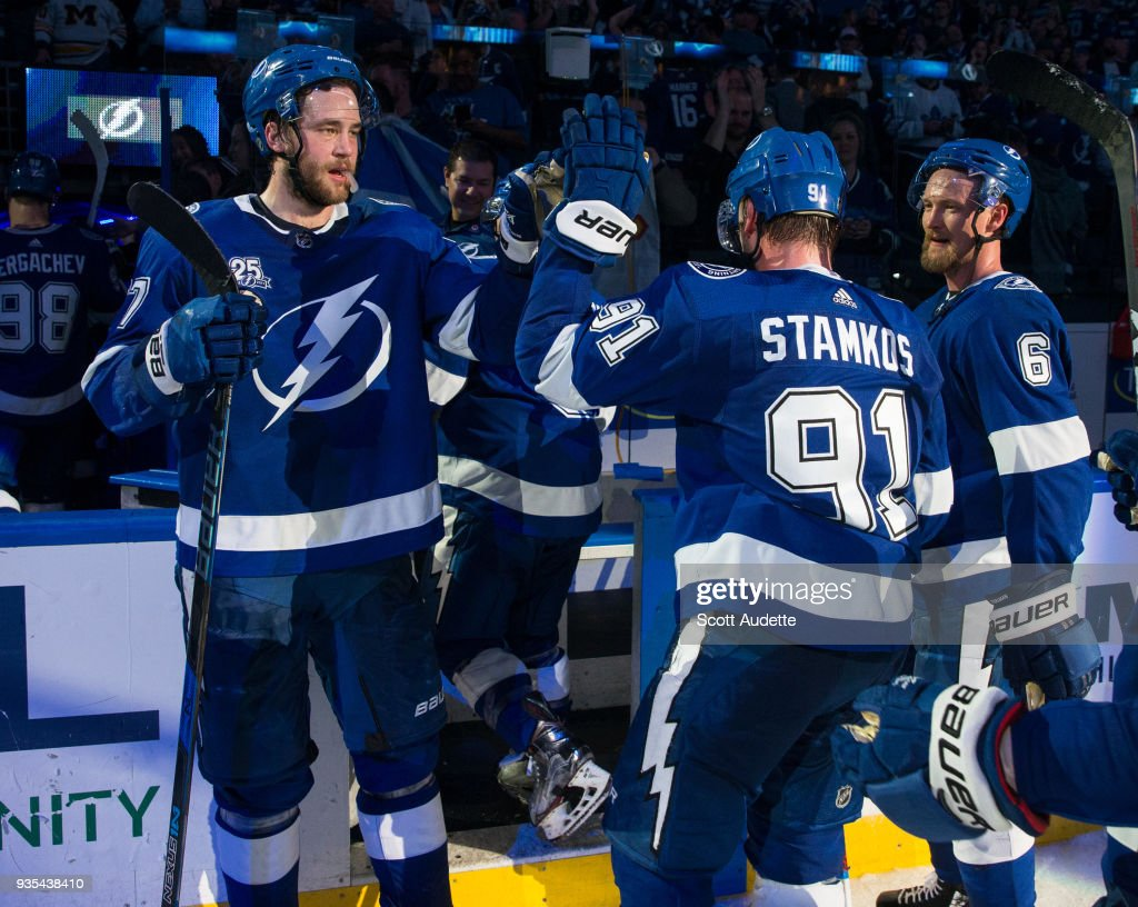 Victor Hedman #77 and Steven Stamkos #91 of the Tampa Bay Lightning celebrate the win against the Toronto Maple Leafs at Amalie Arena on March 20, 2018 in Tampa, Florida.