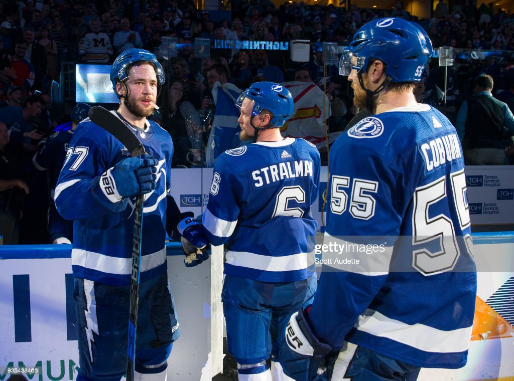Victor Hedman #77, Anton Stralman #6, and Braydon Coburn of the Tampa Bay Lightning celebrate the win against the Toronto Maple Leafs at Amalie Arena on March 20, 2018 in Tampa, Florida.