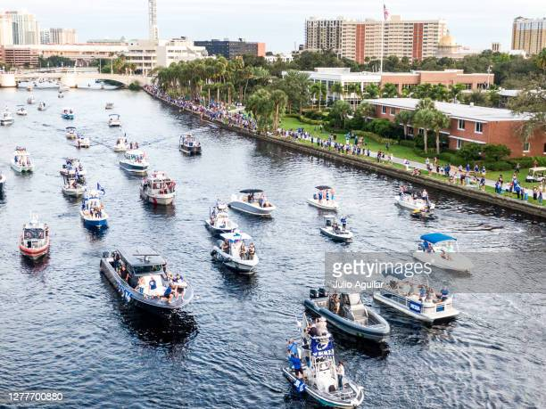 Victor Hedman drinks from the Stanley Cup held by Steven Stamkos on the black boat at the Tampa Bay Lightning Victory Rally & Boat Parade on the...