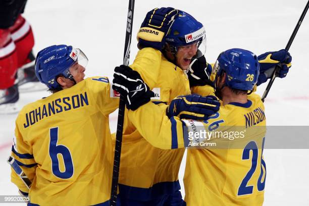 Victor Hedman of Sweden celebrates his team's third goal with team mates Magnus Johansson and Marcus Nilson during the IIHF World Championship group...