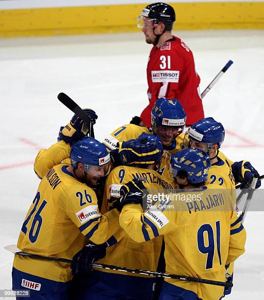 Victor Hedman of Sweden celebrates his team's third goal with team mates during the IIHF World Championship group E qualification round match between...