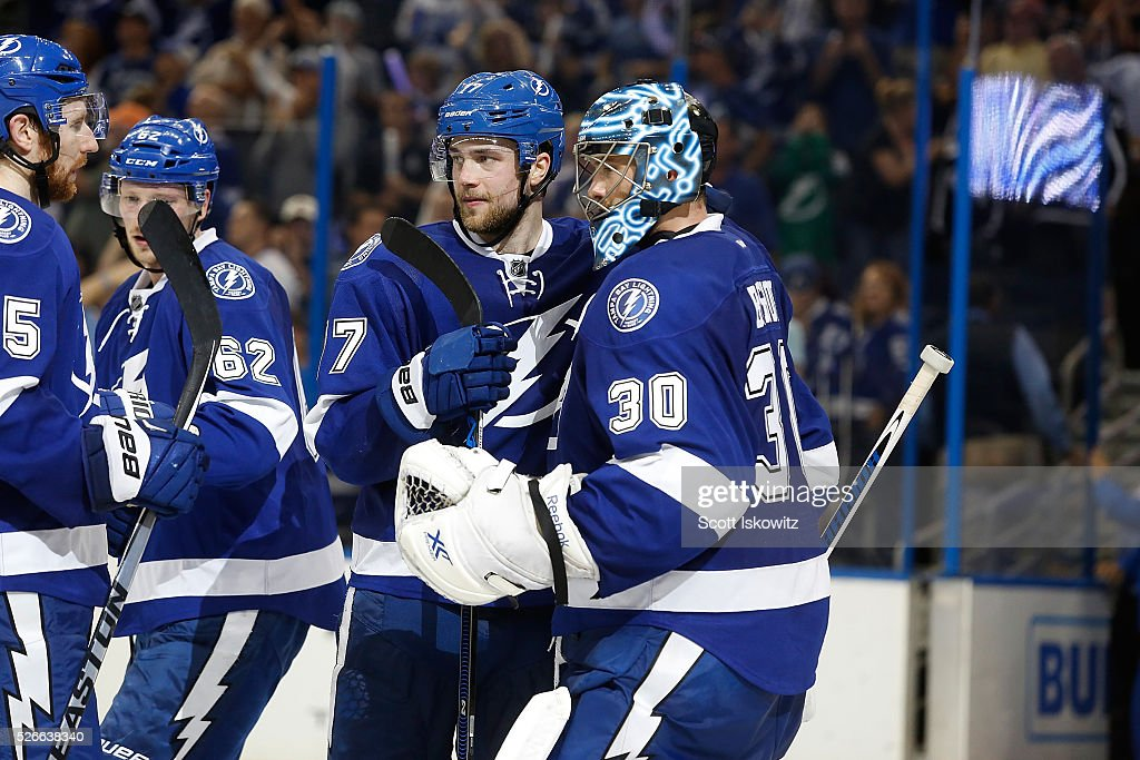 Victor Hedman #77 of the Tampa Bay Lightning celebrates a win with teammate Ben Bishop #30 of the Tampa Bay Lightning at the end of the third period in Game Two of the Eastern Conference Second Round during the 2016 NHL Stanley Cup Playoffs at Amalie Arena on April 30, 2016 in Tampa, Florida.