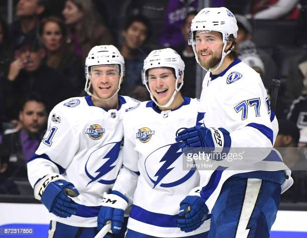 Victor Hedman of the Tampa Bay Lightning celebrates his goal with Yanni Gourde and Brayden Point to take a 30 lead over the Los Angeles Kings during...