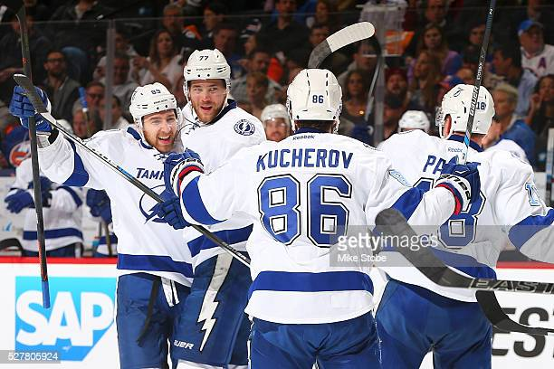 Victor Hedman of the Tampa Bay Lightning celebrates his second period goal with teammates Nikita Nesterov Nikita Kucherov and Ondrej Palat against...