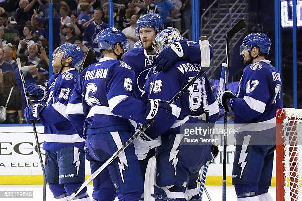 Victor Hedman of the Tampa Bay Lightning celebrates with Andrei Vasilevskiy after defeating the Pittsburgh Penguins in Game Four of the Eastern...