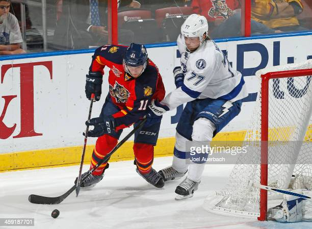 Victor Hedman of the Tampa Bay Lightning defends against Jonathan Huberdeau of the Florida Panthers as he circles the net with the puck at the BBT...