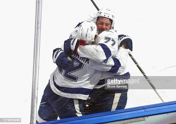 Victor Hedman of the Tampa Bay Lightning embraces Kevin Shattenkirk following his game winning goal in overtime in Game Four of the 2020 NHL Stanley...