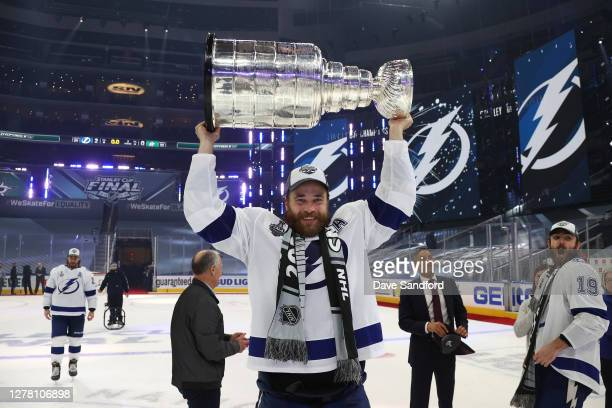 Victor Hedman of the Tampa Bay Lightning hoists the Stanley Cup overhead after the Lightning defeated the Dallas Stars 2-0 in Game Six of the NHL...