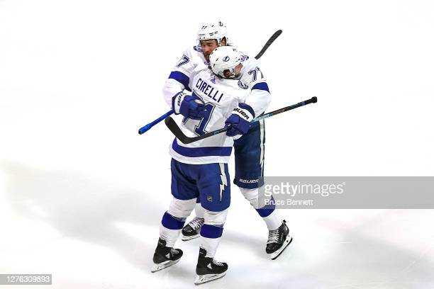 Victor Hedman of the Tampa Bay Lightning is congratulated by Anthony Cirelli after scoring a goal against the Dallas Stars during the second period...