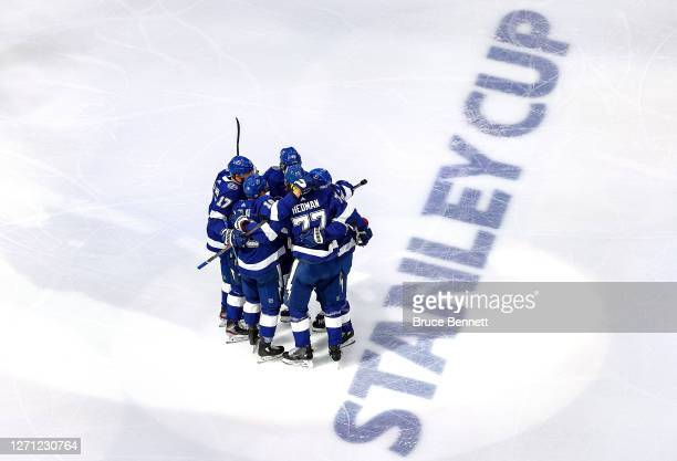 Victor Hedman of the Tampa Bay Lightning is congratulated by his teammates after scoring a goal against the New York Islanders during the first...