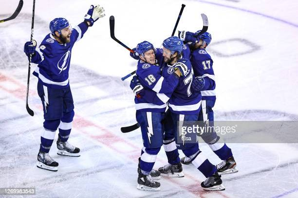 Victor Hedman of the Tampa Bay Lightning is congratulated by his teammates, Ondrej Palat, Alex Killorn, and Barclay Goodrow after scoring the...