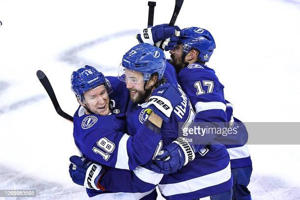 Victor Hedman of the Tampa Bay Lightning is congratulated by his teammates Ondrej Palat Alex Killorn after scoring the gamewinning goal during the...