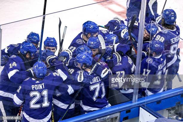 Victor Hedman of the Tampa Bay Lightning is congratulated by his teammates after scoring the gamewinning goal during the second overtime period to...