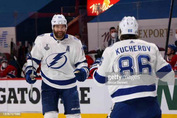 Victor Hedman of the Tampa Bay Lightning is congratulated by Nikita Kucherov after scoring a goal against the Montreal Canadiens during the first...