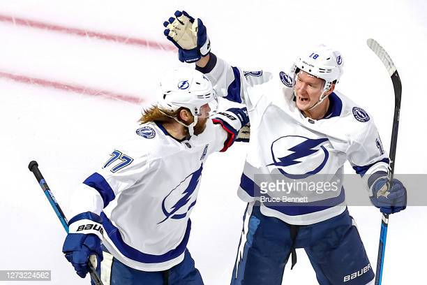 Victor Hedman of the Tampa Bay Lightning is congratulated by Ondrej Palat after scoring a goal against the New York Islanders during the first period...