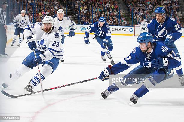 Victor Hedman of the Tampa Bay Lightning poke checks the puck away from Jerry D'Amigo of the Toronto Maple Leafs during the second period at the...