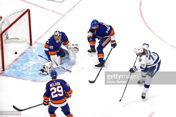 Victor Hedman of the Tampa Bay Lightning scores a goal past Semyon Varlamov of the New York Islanders during the first period in Game Six of the...
