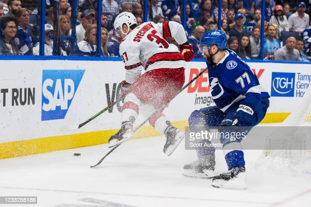Victor Hedman of the Tampa Bay Lightning skates against Andrei Svechnikov of the Carolina Hurricanes during the second period in Game Three of the...