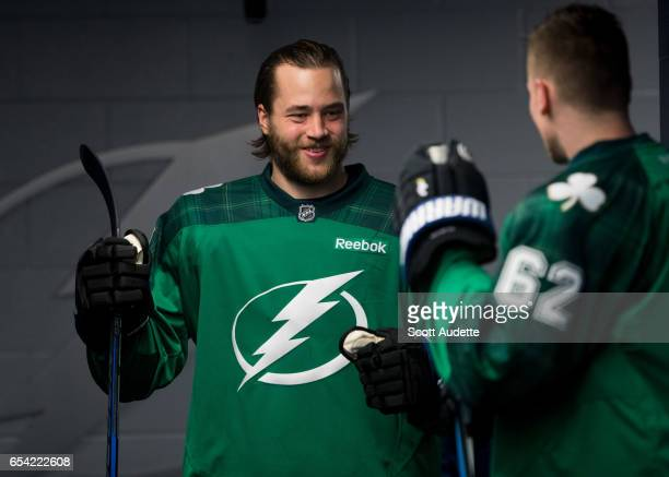 a28a3ab75 Victor Hedman of the Tampa Bay Lightning wears a green St Patrick's Day  warmup jersey as