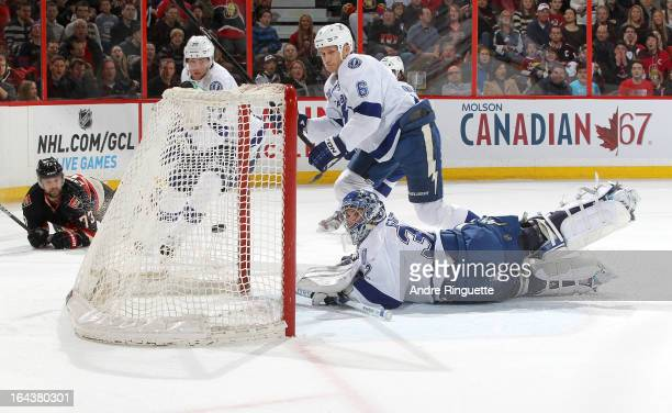 Victor Hedman Sami Salo and Mathieu Garon of the Tampa Bay Lightning watch the puck go into the net for a first period goal by Guillaume Latendresse...