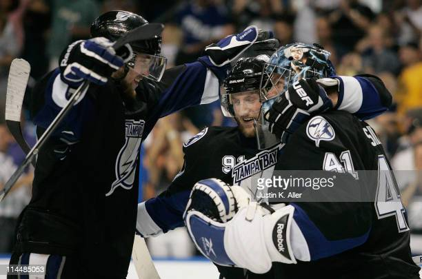Victor Hedman, Steven Stamkos of the Tampa Bay Lightning, and Mike Smith of the Tampa Bay Lightning celebrate after defeating the Boston Bruins 5 to...