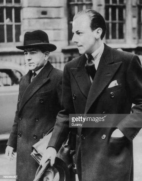 Victor Hervey, 6th Marquis of Bristol, right, outside court in Marlborough Street after a hearing on charges of jewel theft, 16th May 1939. He was...