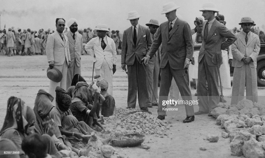 Victor Hope the 2nd Marquess of Linlithgow the Viceroy and GovernorGeneral of India watches female workers breaking stones for road construction...