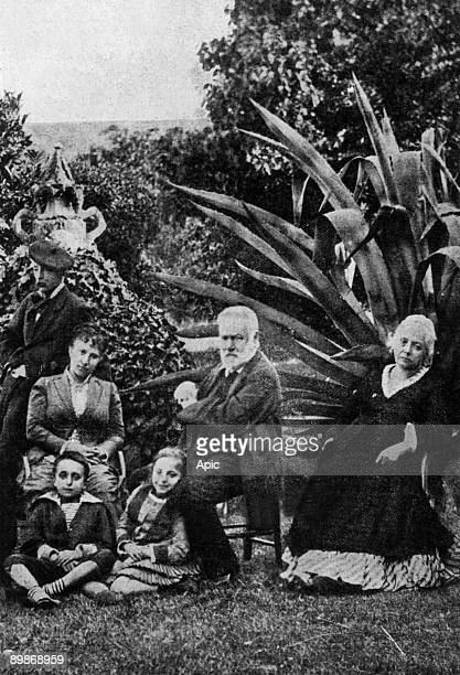 Victor Hugo in family at Hauteville House in Guernesey c 1874 Victor Hugo with his grand children Georges and Jeanne on r Juliette Drouet