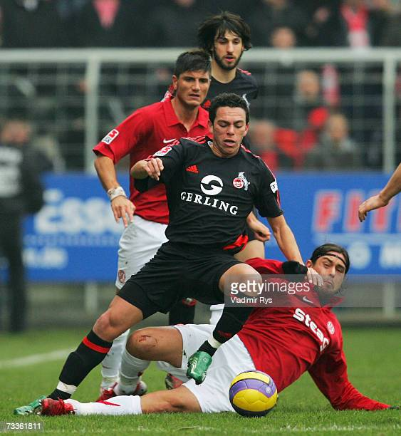 Victor Hugo Lorenzon of Essen and Andre of Cologne battle for the ball during the Second Bundesliga match between Rot Weiss Essen and 1FC Cologne at...