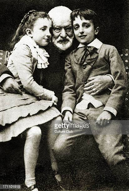 Victor Hugo Portait of the French author at home with his grandchildren Georges and Jeanne 18021885 Caption reads Maison de Victor Hugo Victor Hugo...