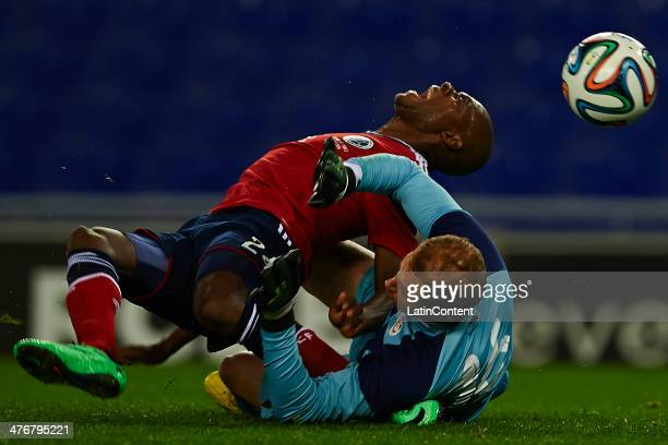 Victor Ibarbo of Colombia being fouled by Enis Hajri during the International friendly match between Colombia and Tunisia at Cornella el Prat Stadium...