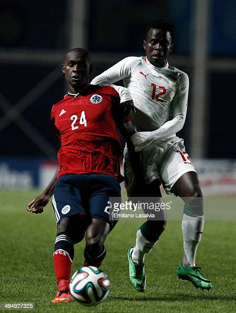 Victor Ibarbo of Colombia fights for the ball with Mamadou Ndiaye of Senegal during the International Friendly match between Colombia and Senegal at...