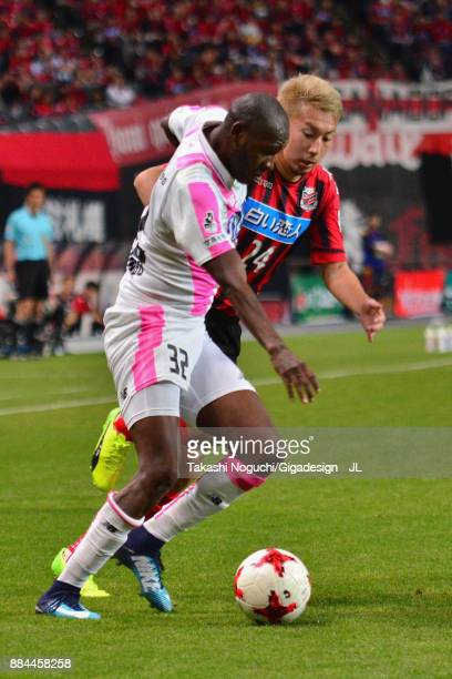 Victor Ibarbo of Sagan Tosu and Akito Fukumori of Consadole Sapporo compete for the ball during the JLeague J1 match between Consadole Sapporo and...