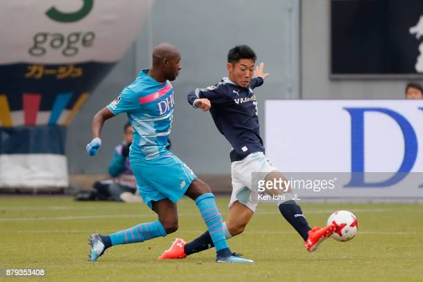 Victor Ibarbo of Sagan Tosu and Rikiya Uehara of Jubilo Iwata compete for the ball during the JLeague J1 match between Sagan Tosu and Jubilo Iwata at...