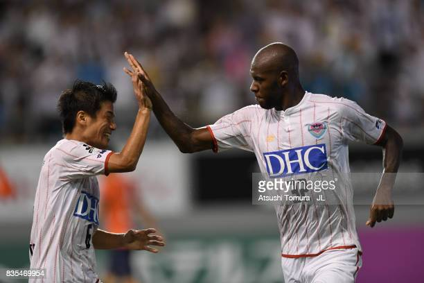 Victor Ibarbo of Sagan Tosu celebrates scoring the opening goal with his team mate Akito Fukuta during the J.League J1 match between Sagan Tosu and...