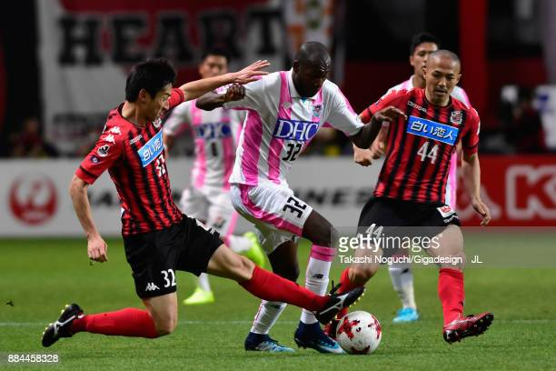 Victor Ibarbo of Sagan Tosu competes for the ball against Naoki Ishikawa and Shinji Ono of Consadole Sapporo during the JLeague J1 match between...