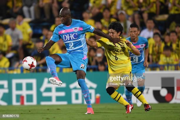 Victor Ibarbo of Sagan Tosu controls the ball under pressure of Yusuke Kobayashi of Kashiwa Reysol during the JLeague J1 match between Kashiwa Reysol...