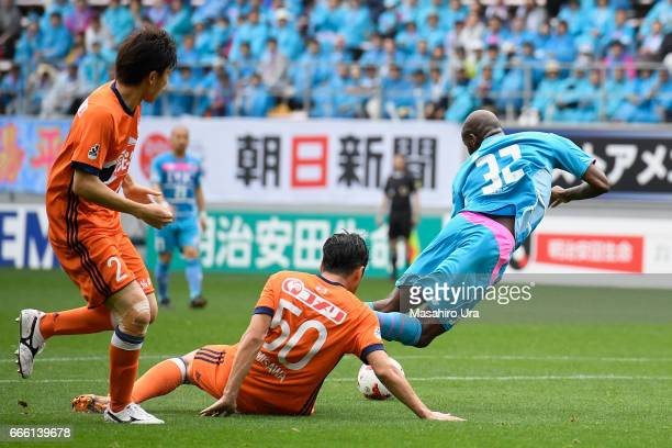 Victor Ibarbo of Sagan Tosu is fouled by Seitaro Tomisawa of Albirex Niigata resulting in a penalty kick to Tosu during the J.League J1 match between...