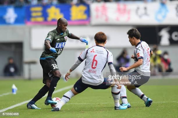 Victor Ibarbo of Sagan Tosu takes on Kosuke Ota and Kensuke Nagai of FC Tokyo during the JLeague J1 match between Sagan Tosu and FC Tokyo at Best...