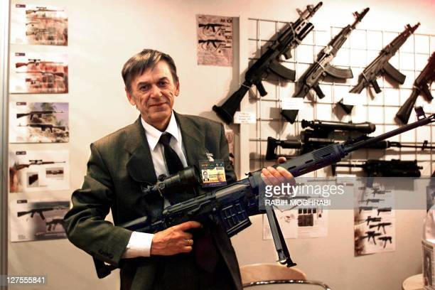 Victor Kalachnikov son of Russian Michael Kalachnikov the inventor of the famous Ak47 submachinegun shows a model of a heavy machinegun at his stand...