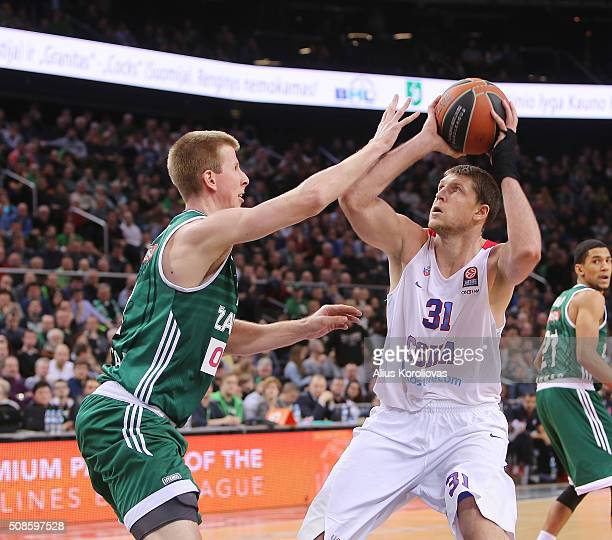 Victor Khryapa, #31 of CSKA Moscow competes with Brock Motum, #12 of Zalgiris Kaunas in action during the Turkish Airlines Euroleague Basketball Top...