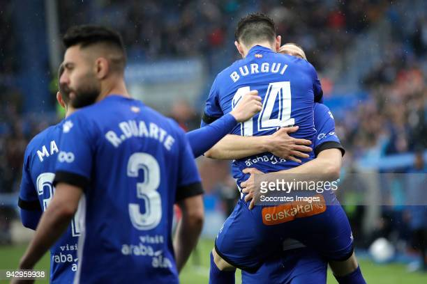 Victor Laguardia of Deportivo Alaves celebrates 10 with Burgui of Deportivo Alaves during the La Liga Santander match between Deportivo Alaves v...