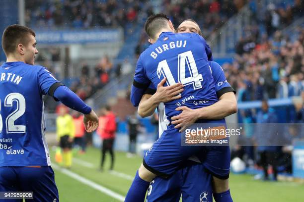 Victor Laguardia of Deportivo Alaves celebrates 10 with Martin Aguirregabiria of Deportivo Alaves Burgui of Deportivo Alaves during the La Liga...