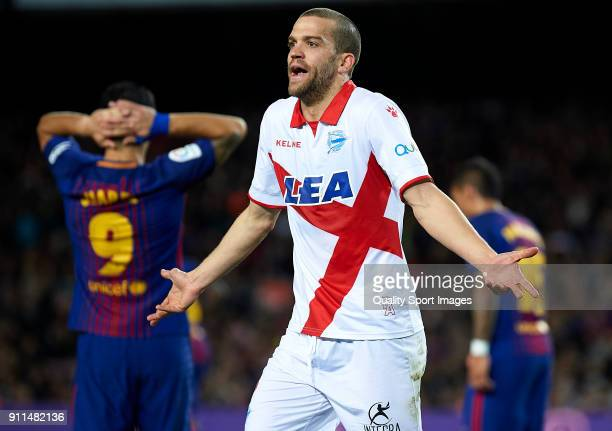 Victor Laguardia of Deportivo Alaves reacts during the La Liga match between Barcelona and Deportivo Alaves at Camp Nou on January 28 2018 in...