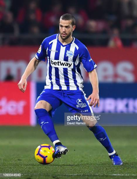 Victor Laguardia of Deportivo Alaves runs with the ball during the La Liga match between Girona FC and Deportivo Alaves at Montilivi Stadium on...