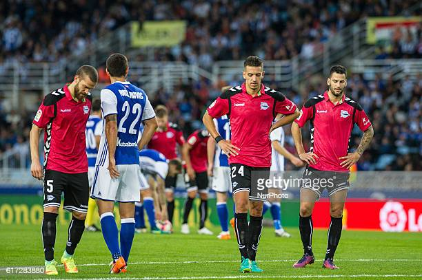 Victor Laguardia Zouhair Feddal and Edgar Mendez of Alaves reacts during the Spanish league football match between Real Sociedad and Betis at the...