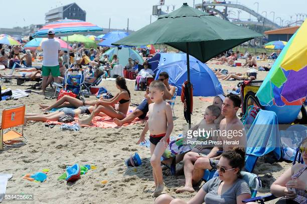 Victor Lefebure heads to the beach as his family relaxes under an umbrella where Canadians vacationing at Old Orchard Beach talk about the exchange...