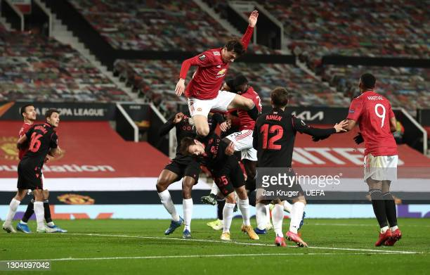 Victor Lindeloef of Manchester United collides with Jon Bautista of Real Sociedad which leads to Axel Tuanzebe of Manchester United goal being...