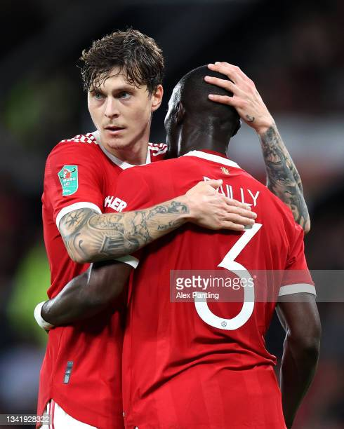 Victor Lindeloef of Manchester United interacts with teammate Eric Bailly during the Carabao Cup Third Round match between Manchester United and West...