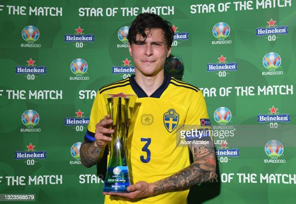 """Victor Lindeloef of Sweden poses for a photograph with their Heineken """"Star of the Match"""" award after the UEFA Euro 2020 Championship Group E match..."""